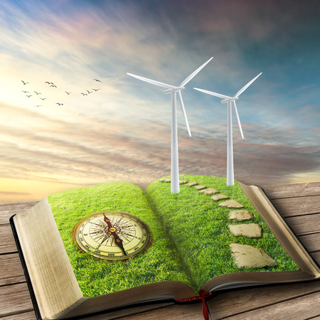 wind force wheel: Wind Generators, Ecology. Future of energy industry concept. Opened book covered with green grass compass and wind turbines installed with beautiful sky background. Creative screen saver illustration