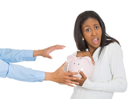 portrait young shocked woman holding piggy bank, looking scared, angry, frustrated trying to protect her savings from being stolen isolated on white background. Financial risk fraud, robbery concept