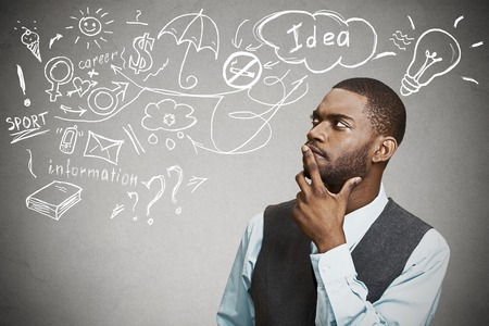 Portrait handsome man thinking dreaming has many ideas looking up isolated on grey wall background. Positive human face expression emotion feeling life perception. Decision making process concept