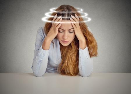 vertigo: Woman with vertigo. Young female patient suffering from dizziness.