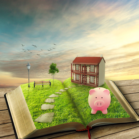 Home savings financial concept. Piggy bank and opened magic book covered with green grass and stoned path way. Fantasy world imaginary view. Original screensaver. Loan market housing industry mortgage Фото со стока