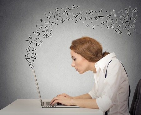 concepts alphabet: Woman typing on her laptop computer with alphabet letters flying around Stock Photo
