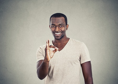 good deal: happy handsome man giving ok sign