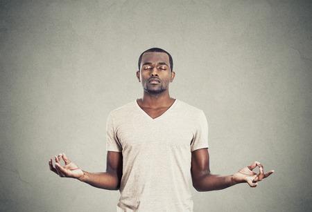 Young man meditating 스톡 콘텐츠