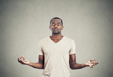 breath: Young man meditating Stock Photo