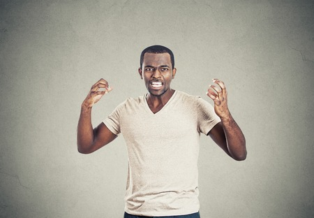 pissed off: Portrait mad displeased pissed off angry man arms hands in air screaming yelling isolated on grey background. Negative human facial expression feeling