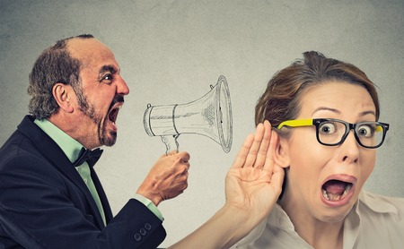 a public notice: Side profile angry man screaming in megaphone curious nosy woman listening  isolated on wall background. Negative face expression emotion feeling. Propaganda breaking news social media power concept