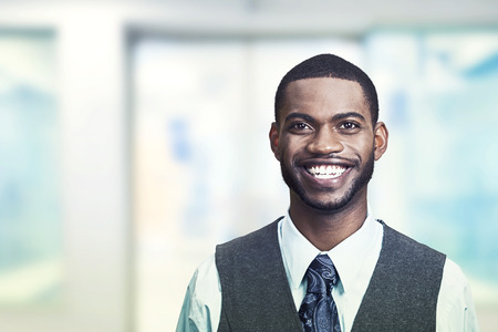 afro man: Portrait of a young smiling businessman. Positive face expression Stock Photo