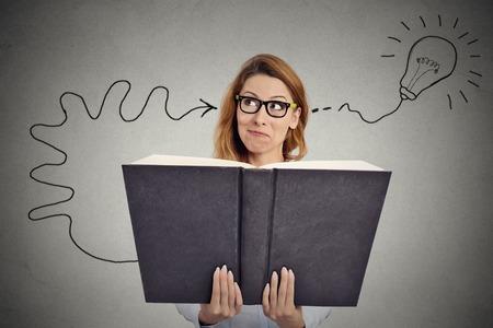 Woman reading a huge book has a good idea