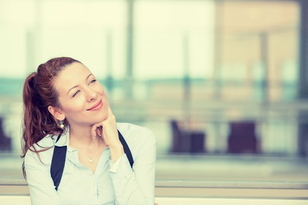 idea: Portrait happy young woman thinking dreaming has many ideas looking up isolated office windows background. Positive human face expression emotion feeling reaction. Decision making process concept