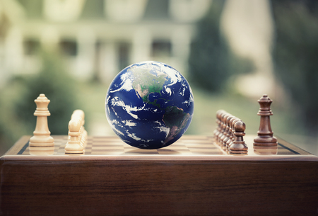 Real estate sale, home savings, loans market concept. Housing industry globalization. Chess game figures with earth globe isolated outside home background. photo