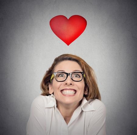 exaggerate: Proposal anticipation. Closeup young funky woman in love on gray wall background