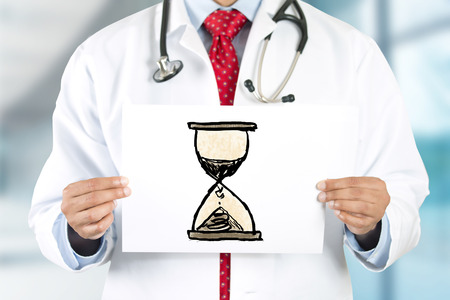 money time: Doctor hands holding sign with san clock