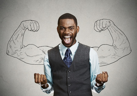 new business: Closeup portrait happy successful student, business man winning, fists pumped celebrating success isolated grey wall background. Positive human emotion facial expression. Life perception, achievement