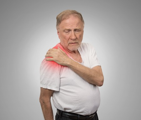 dislocation: senior man with pain in his shoulder Stock Photo