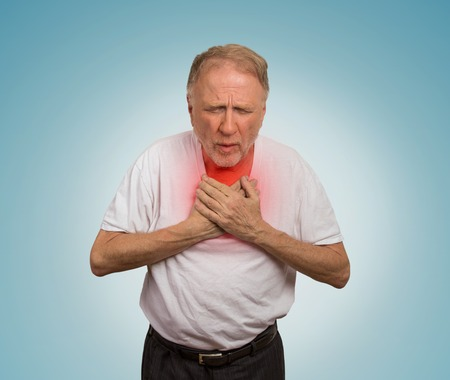 dyspnea: Closeup portrait sick old man, elderly guy, having severe infection, chest pain, looking miserable unwell, trying to catch his breath isolated on light blue background. Geriatric health care concept