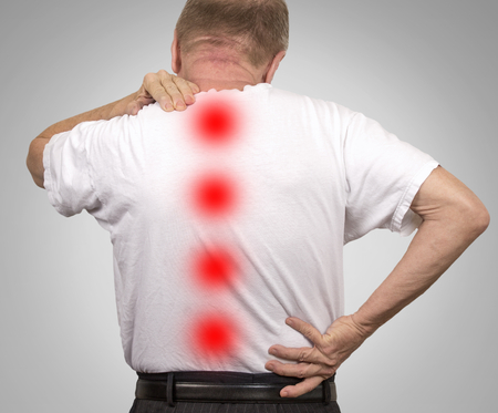 Senior elderly man with backache isolated on gray background. Health care patient concept
