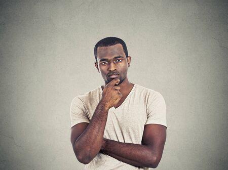 skeptical: Skeptical young man Stock Photo