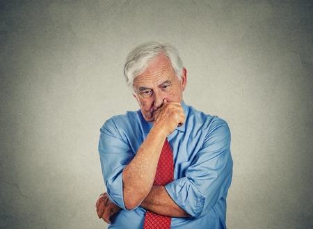 Closeup sad worried senior business man photo