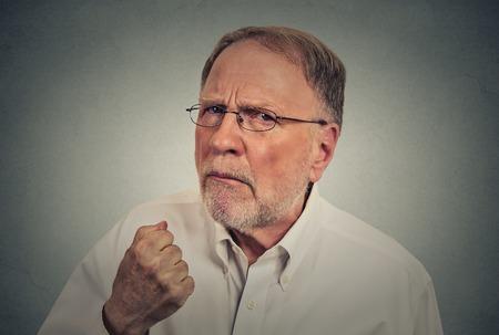 grumpy old man: Closeup elderly angry man