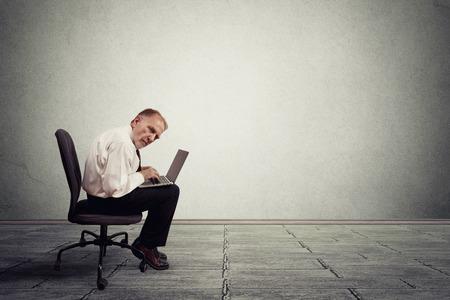 hard to find: Senior man working on laptop computer