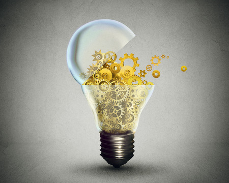 technology metaphor: Creative technology and communication concept as an open door light bulb transferring gears and cogs.Business metaphor for downloading or uploading innovation solutions. Stock Photo