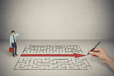 shortcut: Business man looking at hand drawing solution for maze Stock Photo