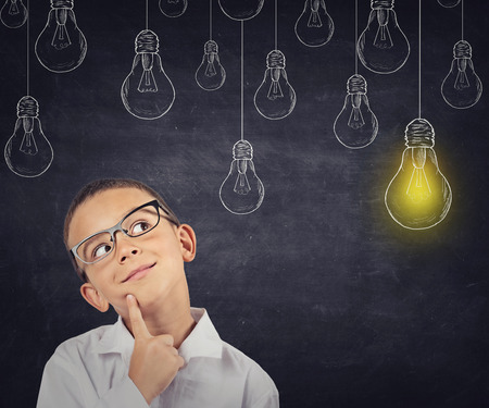 creative mind: Big idea. Smart boy with solution lightbulb above head