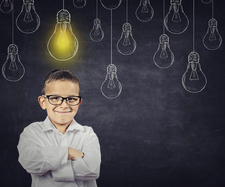 Big idea. Smart boy with solution lightbulb above head photo