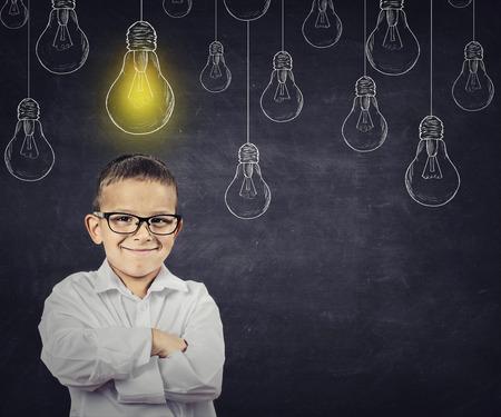 smart boy: Big idea. Smart boy with solution lightbulb above head