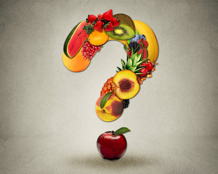 eating questions: Fresh diet questions concept as group of fruits in the shape of question mark as symbol of good high fiber healthy eating and information on natural nutrition