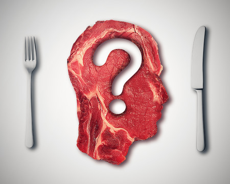 Eating meat questions concept or diet and nutrition decisions as red steak in the shape of  human head with question mark cut out of the raw food as dinner table setting with fork and knife