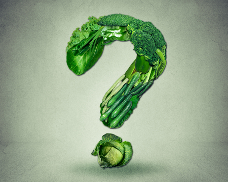 eating questions: Green diet questions concept as a group of fresh fruit and vegetables in the shape of a question mark as a symbol of good high fiber healthy eating and information on natural nutrition. Stock Photo