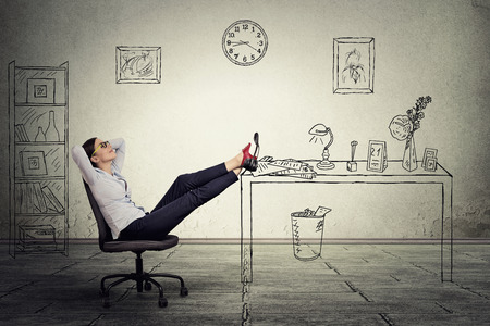 woman boss: young businesswoman relaxing sitting in the office
