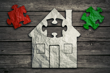 loans: Home repair concept improvement symbol as crumpled paper shaped as residential structure with puzzle pieces. Icon for renovations maintenance. Real estate sale saving loan market. Housing industry Stock Photo