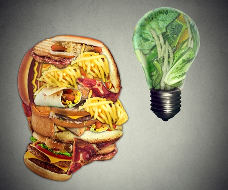 greasy: Diet Motivation and dieting inspiration concept. Human head made of greasy junk food with  lightbulb idea icon made of green fruits and vegetables as nutrition health care metaphor.