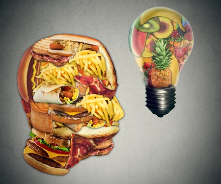 dieting: Diet Motivation and dieting inspiration concept. Human head made of greasy junk food with a lightbulb idea icon made of fruits as nutrition and health care metaphor.