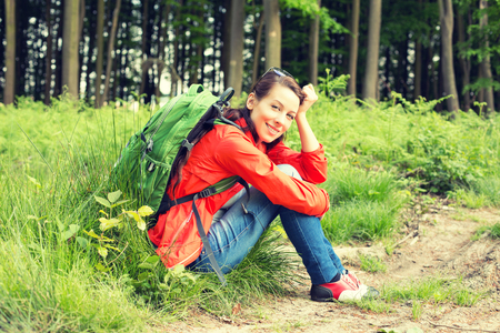 having a break: Young beautiful woman with in a forest, having a break