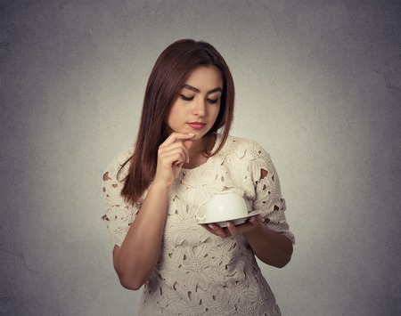 coffee grounds: young woman thinking guessing on coffee grounds Stock Photo
