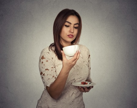 guessing: young woman thinking guessing on coffee grounds Stock Photo