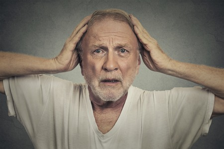 old hand: Shocked sad senior man Stock Photo
