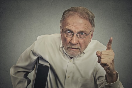 reprimand: Angry senior man pointing his finger at somebody