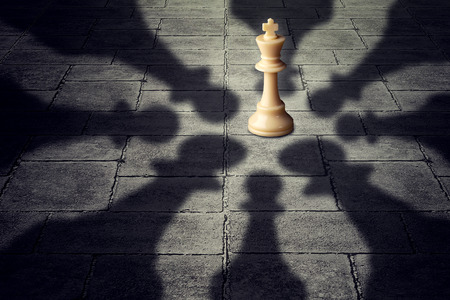 strong partnership: Winning together business team symbol teaming up to defeat a powerful opponent with eight chess pawns encircling the competition forming strong partnership that succeeds over the king as group