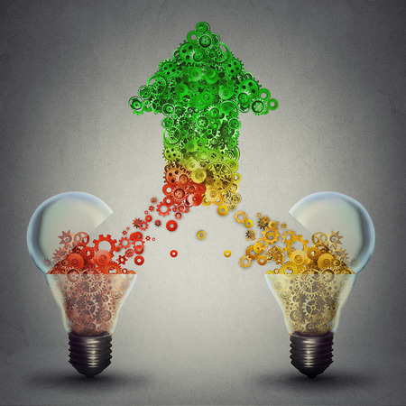 Creative innovation success as two open glass light bulbs releasing gears cogs coming together in the shape of upward arrow symbol of brainstorming new ideas technology development Banque d'images