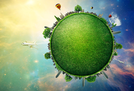 Green planet earth covered with grass city skyline.