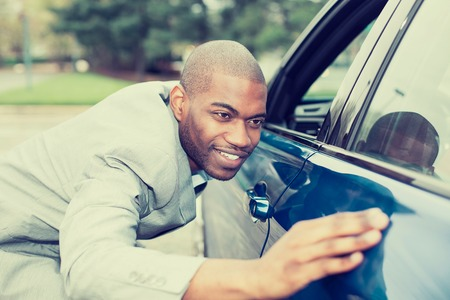 selling service: Excited young man and his new car