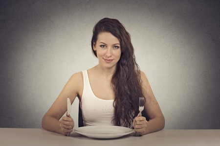 hungry: Happy dieting woman Stock Photo