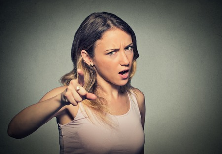 girl pointing: portrait of a angry young woman screaming