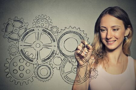 engineer: Woman with gear mechanism Stock Photo
