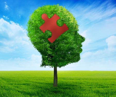 enfermedades mentales: Puzzle cabeza símbolo de aprendizaje del cerebro. Árbol en una forma del perfil de la cara cabeza humana con pieza de puzzle aislado en el cielo azul concepto de salud background.mental